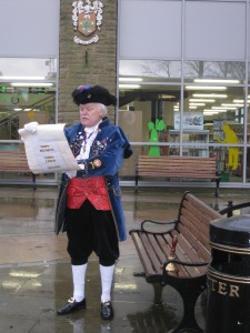 Colne Dynamo: The admirable Nelson town-crier reads out his Lancashire Day proclamation outside Colne Library