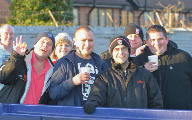 Still Smiling: Woking fans put a brave face on Saturday's events (Photo courtesy of David Holmes)