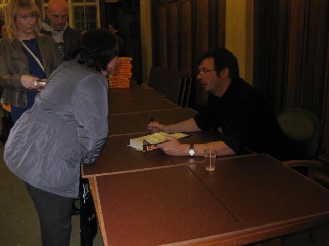 Dedication Time: Ian Rankin signs a copy of Standing in Anorther Man's Grave at Preston