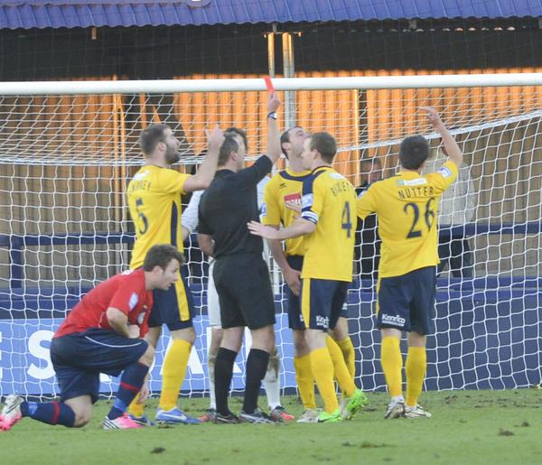 Key Moment: Brett Johnson receives a straight red card, and Woking's game plan is rocked (Photo courtesy of David Holmes)