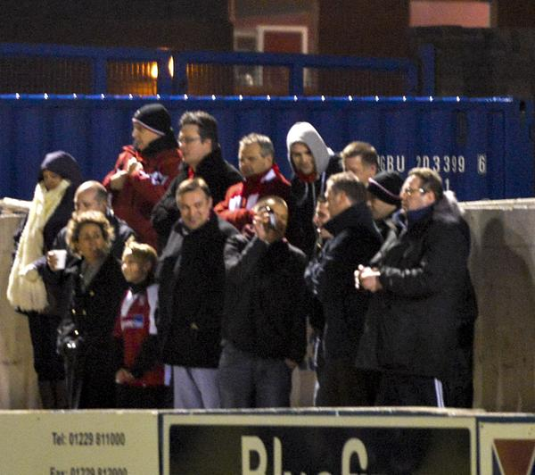 Huddle Formation: The Woking faithful, including a wind-blown blogger (Picture courtesy of David Holmes)