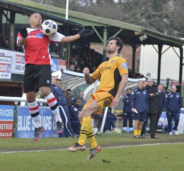 Rising High: Gavin McCallum, watched by Steve Thompson and Garry Hill, gave Woking late hope against Newport (Photo courtesy of David Holmes)