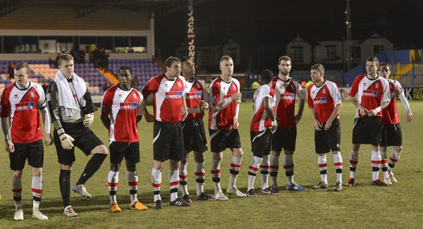 Lining Up: The Woking players get ready for a battling draw at Macclesfield Town (Photo courtesy of David Holmes)