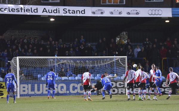 Saving Grace: Woking stopper Seb Brown saves the day at the Moss Rose (Photo courtesy of David Holmes)