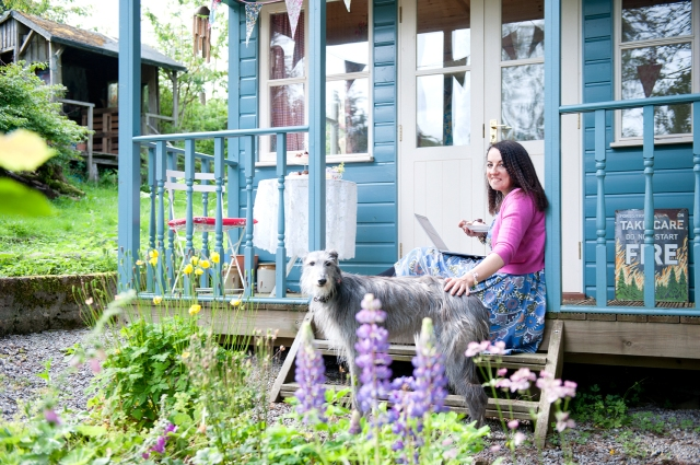 Garden Idyll: Cathy Cassidy with her lurcher, Kelpie, outside her writing hut in the Galloway Hills (Photo courtesy of http://www.cathycassidy.com/)