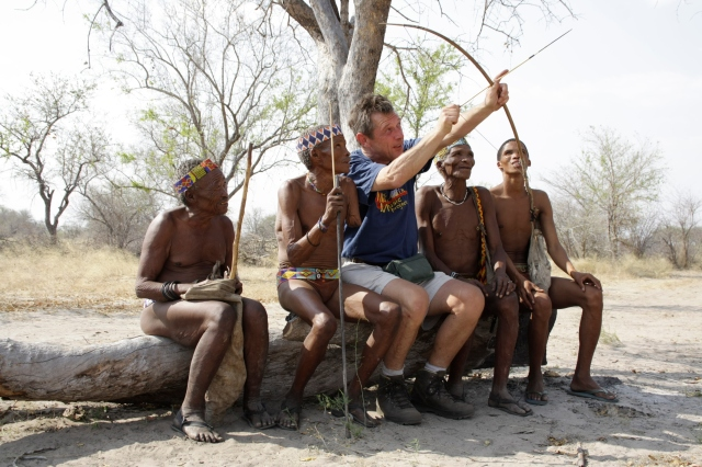 Taking Aim: Andy Kershaw with the bushmen of the Kalahari, Namibia, September 2010, for BBC Radio 3's Music Planet series. (Photo: Marvin Ware)