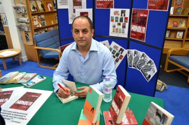 Safe Hands: Bali Rai during an author visit to the John Lyon School in Harrow, Middlesex