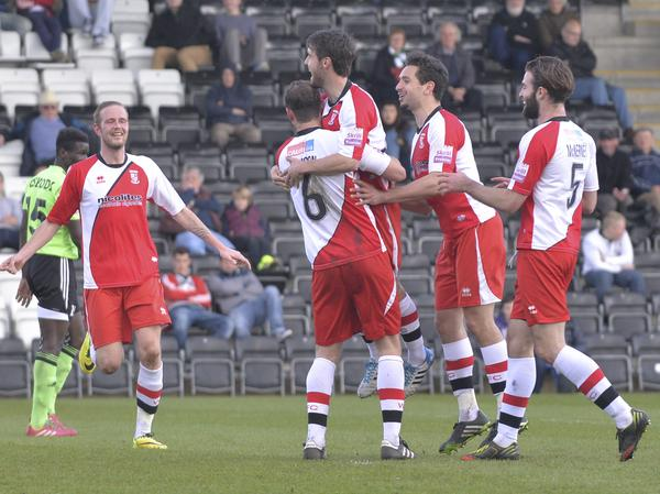 Level Pegging: Woking celebrate Brett Johnson's equaliser at the New Lawn (Photo: David Holmes)