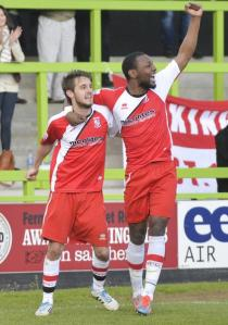 In Front: John Goddard celebrates Woking's second with sub Mike Cestor (Photo: David Holmes)
