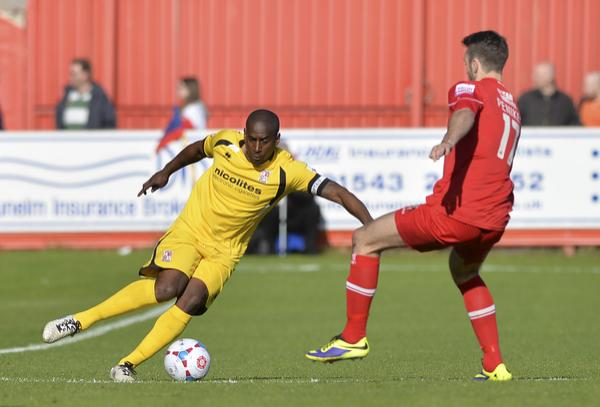 Lamb Chop: Adam Newton shows the way for Woking (Photo: David Holmes)
