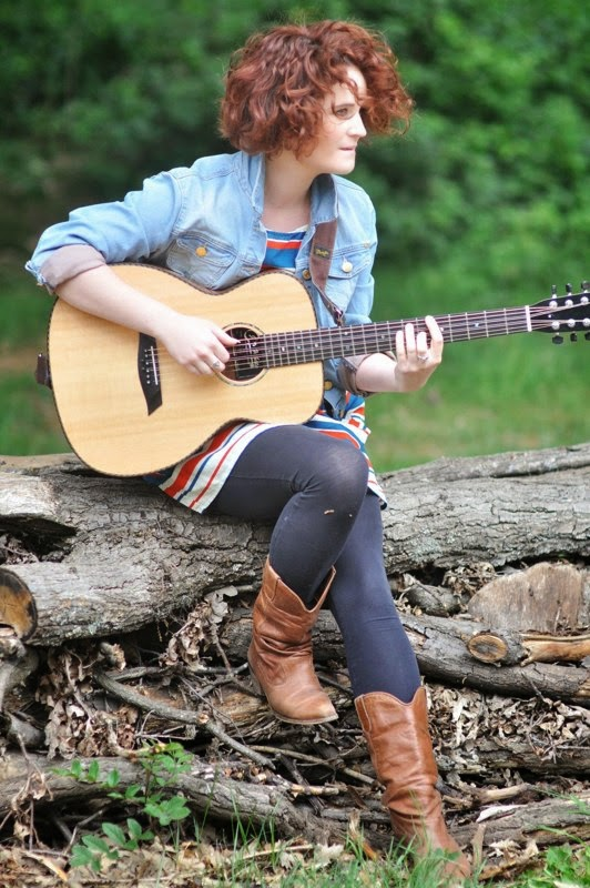 Eight Strings: Lisbee Stainton with her custom-made guitar (Photograph copyright: Eleanor Doughty)