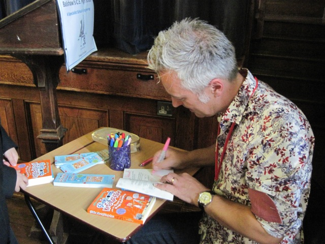 Signing On: John Dougherty  dedicates a book to a new fan (Photo: Catherine Sinclair)