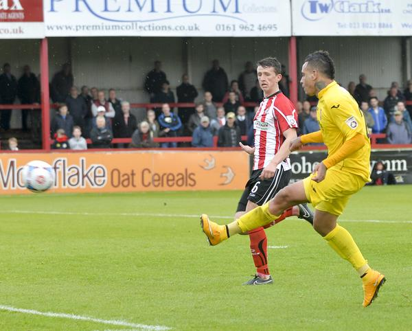 Dynamic Deano: Woking's Dean Morgan unleashes a killer second at Altrincham (Photo: David Holmes)