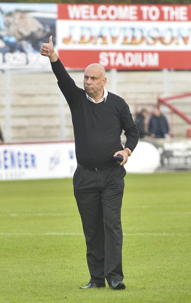 Thumbs Up: Garry Hill gives the Woking faithful his verdict at Alty (Photo: David Holmes)