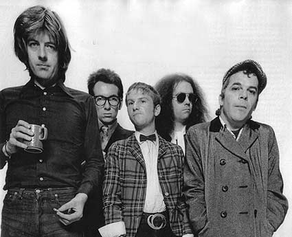 Famous Five: From the left, Nick Lowe, Elvis Costello, Wreckless Eric, Larry Wallis and Ian Dury, presumably  waiting for the 1977 tour bus
