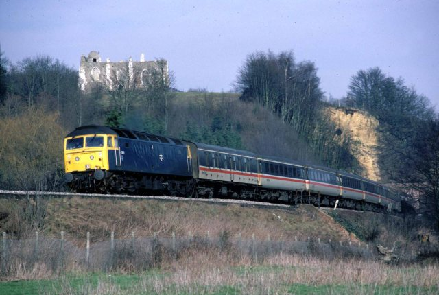 Pompey Bound: A Class 47 diesel-electric emerges from St Catherine's tunnel, Guildford, with a cross-country service from Liverpool to Portsmouth Harbour in the mid-80s, just one of many great shots featured  (Photo: Geoff Burch)