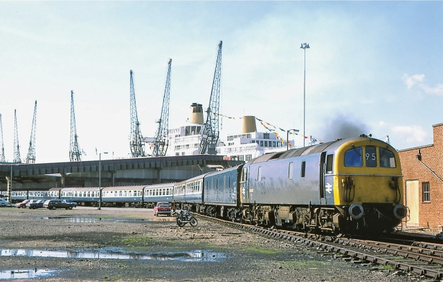 Boat Train: A Class 74 electro-diesel leaves Southampton's old docks bound for Waterloo in May 1975, with the P&O's Oriana in the background (Photo: George Woods)