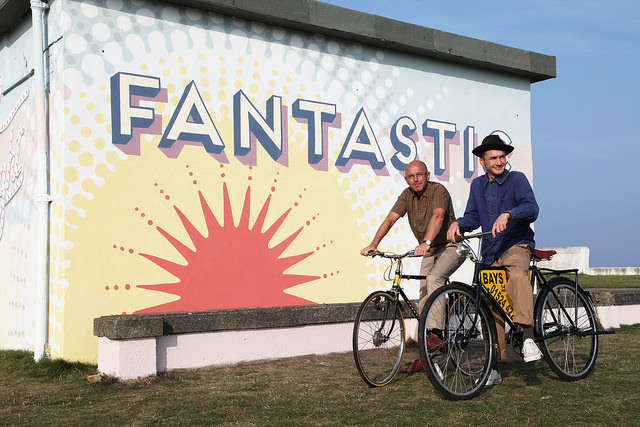 Sun Trap: Wayne and Jack Hemingway enjoy the ride in Morecambe last summer (Photo: Emma Sudall)