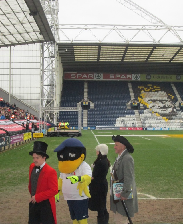 Lining Up: Steve Butler, Deepdale Duck, PNE's Rachel Brennan and Jonny Duddle form an orderly queue, without a burger concession in sight (Pic: Malcolm Wyatt).