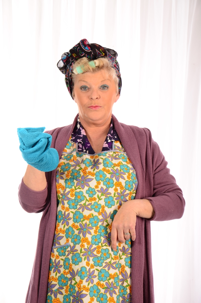 Duster Date: Crissy Rock as Elsie Collins in Dirty Dusting, ready for action