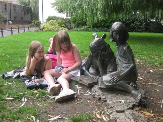 Riverside Wonderland: The bloggers' daughters meet the Liddell sisters in Guildford, 2010, with the rabbit just out of shot (Photo: Malcolm Wyatt)