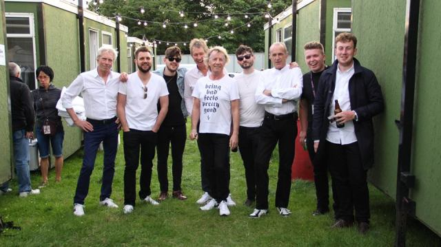 Lining Up: Just another day as Blackburn's New York Tourists pose backstage with the Quo (Photo: New York Tourists/Adam McGrath Photography)
