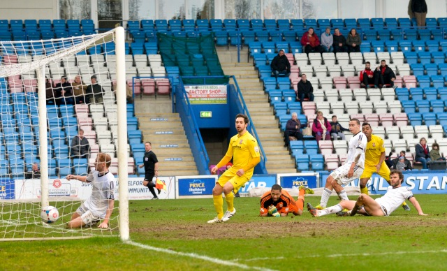 Bucks Stopped: Late scorers Giuseppe Sole and Kevin Betsy look on as the latter's finish beats the Telford keeper (Photo: David Holmes)