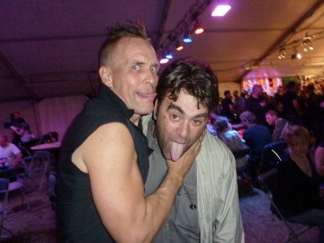 Tongue Tied: A rare shot of Tuff Life Boogie promoter Rico La Rocca, getting friendly with Membranes and Goldblade frontman and Louder than Bombs founder John Robb (Photo: Rico La Rocca)
