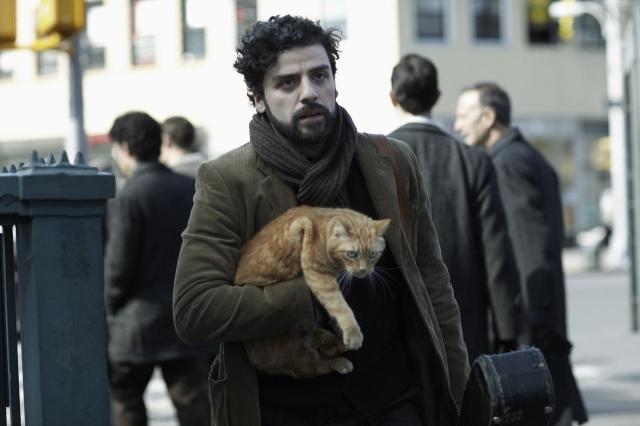 Feline Groovy: Oscar Isaac with his co-star in Inside Llewyn Davis (Image: CBS Films/StudioCanal)