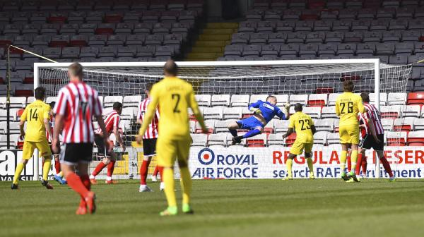 Special K: Midfield maestro Keiran Murtagh puts us ahead at Sincil Bank (Photo: David Holmes)