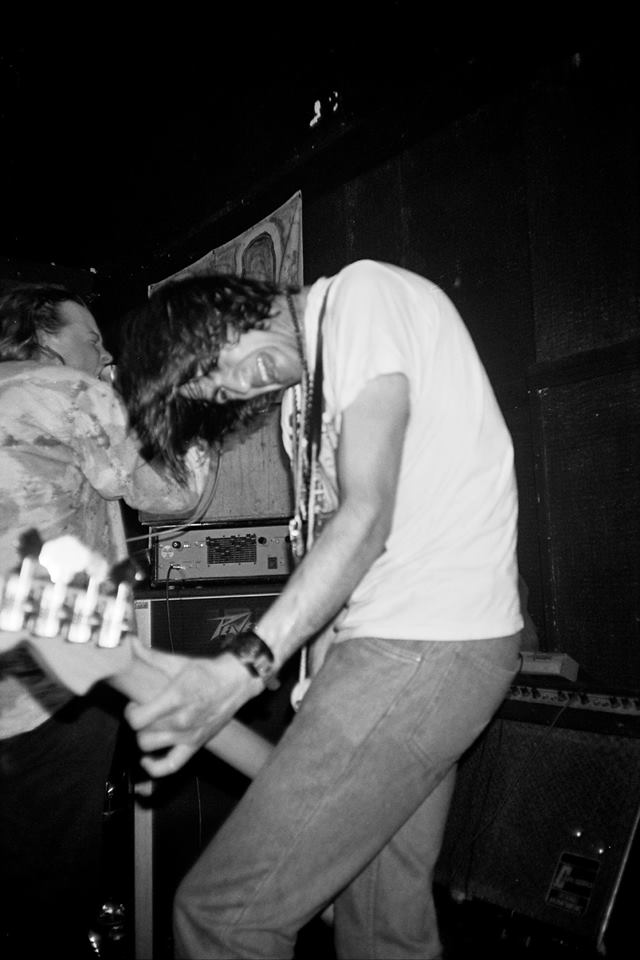 Low-slung Bass: Ajay Saggar wigs out at the Lady Owen Arms with Dandelion Adventure in 1990 (Photo: Greg Neate)