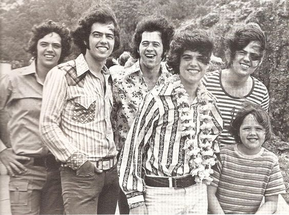 Brotherly Love: Jimmy Osmond (right, front), with five of his performing brothers in the early '70s.