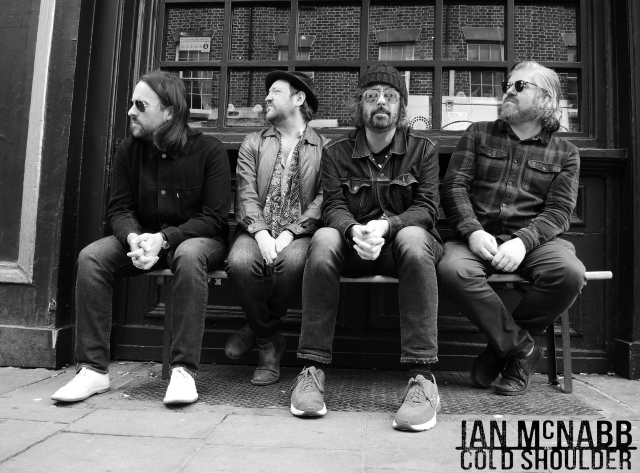 Looking Lively: Cold shoulder waiting on the tour bus to arrive. From left: Nick Kilroe, Christopher Kearney, Ian McNabb, Andy Lord-Ashton